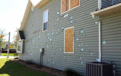 Siding damage from storms in Arlington Heights